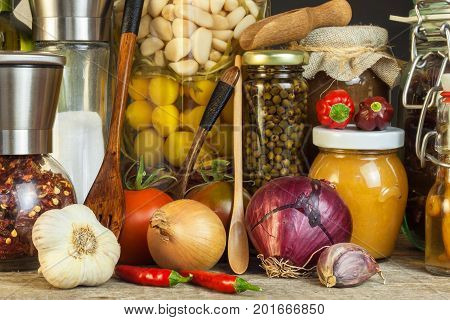 Kitchen table and cooking ingredients. Vegetables and kitchen tools. Recipe for healthy food. Advertising for home cooking