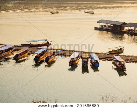 Sangkhlaburi - March 05 2017: The small tourist boats docking at the river in Sangkhlaburi District Kanchanaburi Province Thailand in the early morning.