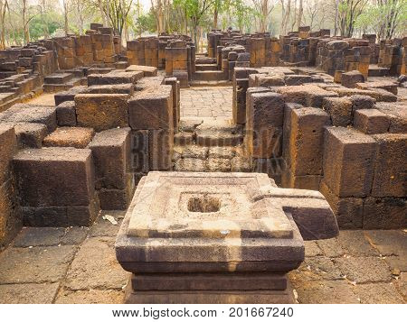 The stone yoni or female sex organ which is a basement of Shiva linga and stone columns inside the ancient Khmer-style temple in Mueang Singh historical park in Kanchanaburi Province Thailand.