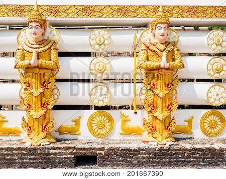 The statues of Deva or Hindu God at the wall of Wangwiwegaram temple in Sangkhlaburi District Kanchanaburi Province Thailand