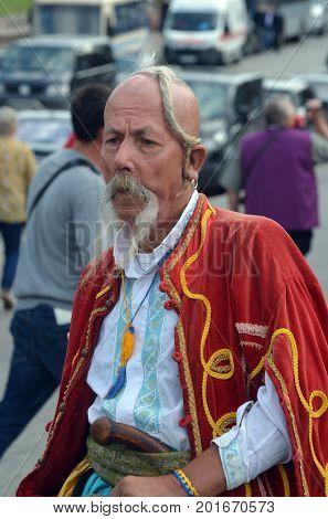 European indian style.Celebration of the Great Victory near Illovaysk.Downtown of Kiev.Old man wears historical costume.August 23, 2017 Kiev, Ukraine