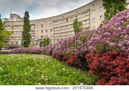 Municipal building in Floridsdorf Vienna with blooming bushes in the foreground