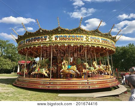 LONDON - AUGUST 27, 2017: Merry go round Carousel at a funfair on Hampstead Heath in Hampstead, London, UK.