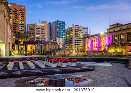 Adelaide Australia - September 16 2016: Adelaide Casino with office buildings on the background viewed through Festival Plaza at dusk