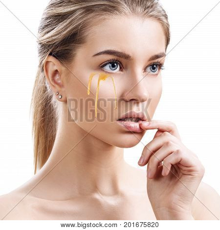 Young woman with honey on face. Honey therapy concept. Isolated on white background.