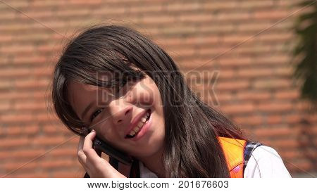 Diverse Female Using Cell Phone And Happy