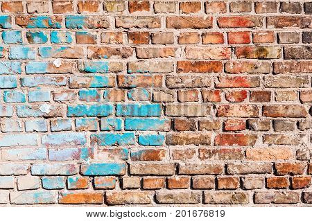 The texture of the brick wall in some places chaotically painted with old paint of blue and white. You can use it as a background for your design.