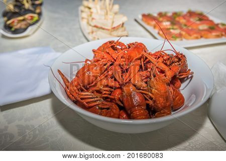 Prepared crayfish boiled with dill in a bowl