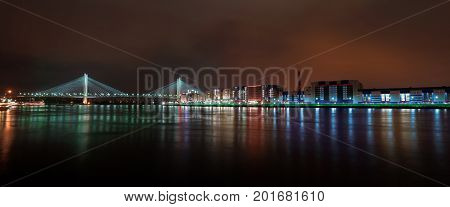 Night lights of St. Petersburg. Fascinating view of night Saint Petersburg city. Big bridge of Europe.