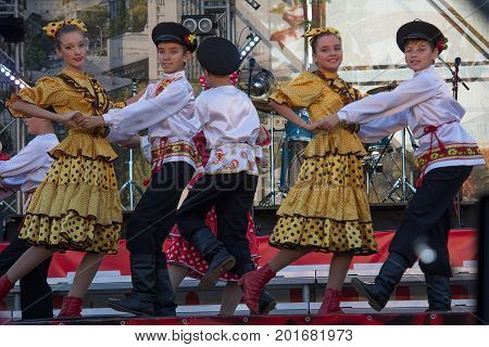 Donetsk Ukraine - August 27 2017 - Children in Russian folk costumes perform a dance on stage during the celebration of the City Day