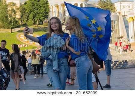 Kiev Ukraine - June 10 2017: Girls with the flag of the European Union on the Independence Square during the celebration of the provision of visa-free regime