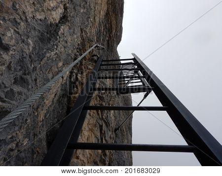mountaineering on Tofana ridge in dolomites in italy