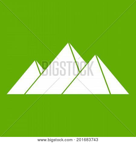 Pyramids in Giza icon white isolated on green background. Vector illustration