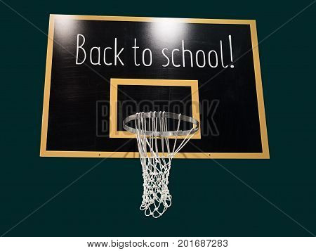 Basketball hoop on blackboard with text Back to school. 1st september concept.