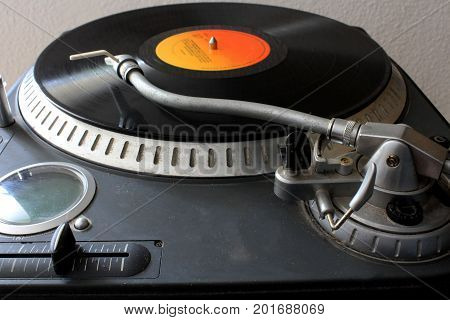 a turntable with vinyl disk on it