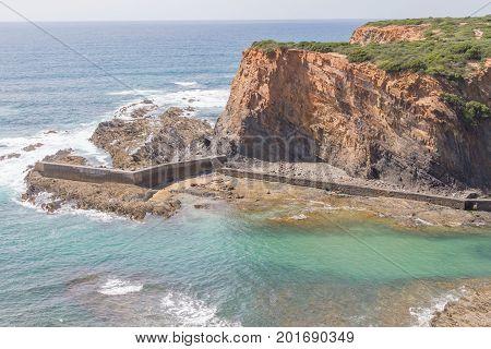 Cliffs, Boat And Waves In Porto Das Barcas, Zambujeira Do Mar