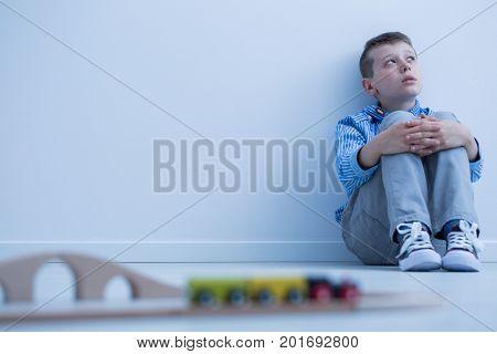 Boy Starring At Wall