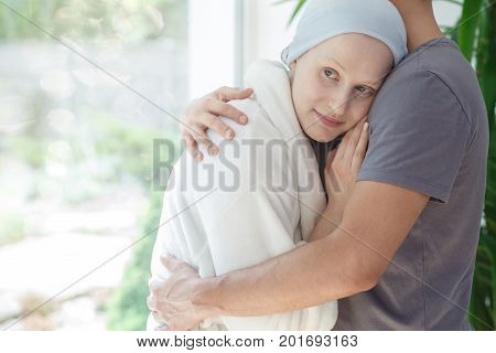 Husband Hugging Woman With Cancer