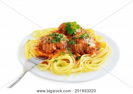 Spaghetti pasta with meatballs and tomato sauce on plate isolated on white