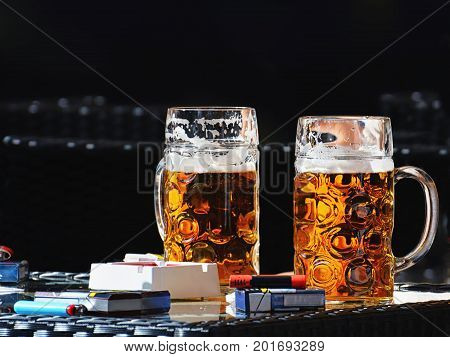 Two pints of beer on the table