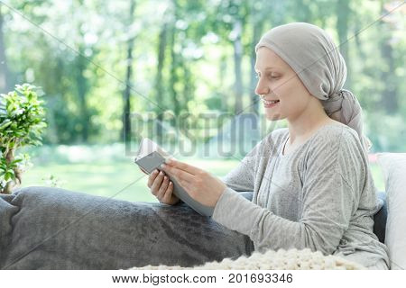 Woman In Headscarf Reading Book