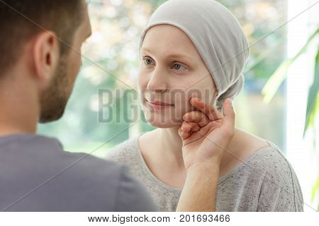 Husband Stroking Ill Wife's Face