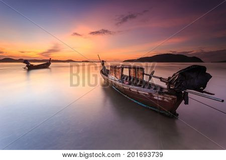 Traditional Thai Long Tail Boat And Beautiful Sunrise At The Sea In Phuket