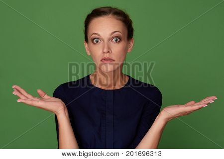 Woman Shrugging Her Hands Isolated On Green