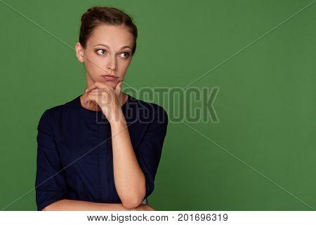 Pretty Brunette Woman Looking Away Having Doubtful