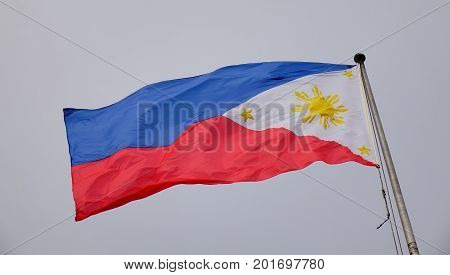 Philippines Flag Waving In The Sky