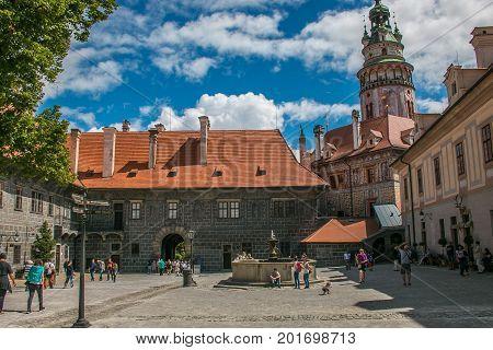 CESKY KRUMLOV, CZECH REPUBLIC - AUGUST 13, 2017: The big castle of Cesky Krumlov with tourists on summer day