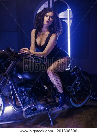 Sexy curly Hot Biker Babe Riding Motorcycle