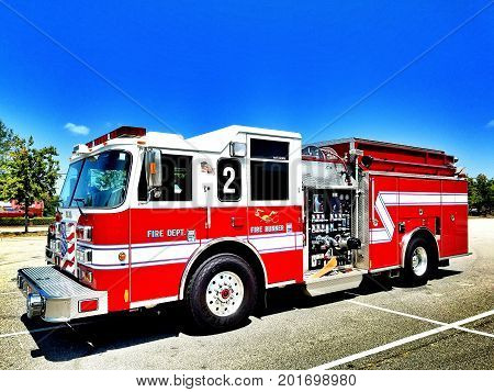 A red American fire engine on the scene in dramatic high definition. Copy space.