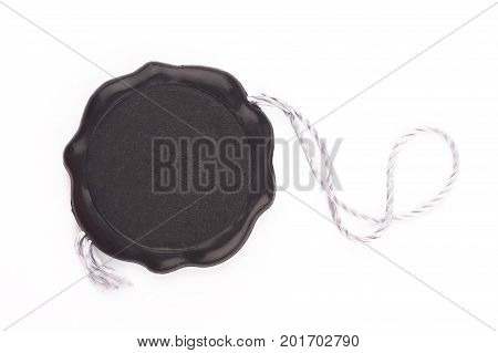 top view of empty black wax plastic seal swing tag with fiber thread and copyspace isolated on white background