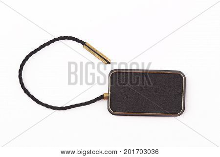 top view of empty black plastic seal swing tag with fiber thread and copyspace isolated on white background