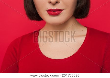 Seductive woman emotion. Beauty makeup closeup. Flirty unrecognizable female. Sexual hints, romantic mood for youth, red background