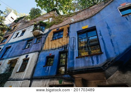 Vienna, Austria - August 15, 2017: Hundertwasserhaus in Vienna. It is is an apartment house in Vienna designed by Friedensreich Hundertwasser. Expressionist landmark of Vienna. Sunny day of summer
