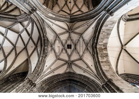 Vienna, Austria - August 16, 2017: Direct below view of vaults of the Cathedral of St Stephen in Vienna. Built in romanesque and gothic style