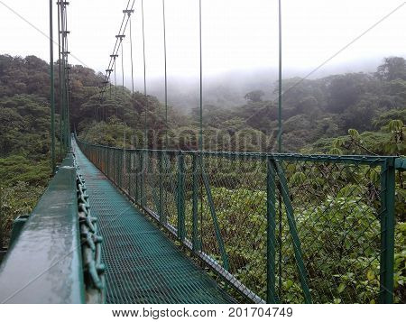 A big suspended bridge over the wild cloudy forest in Monteverde, Costa Rica.