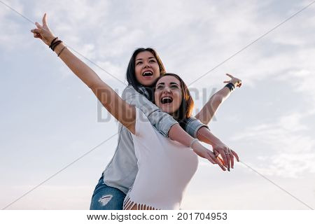 Victory in female friendship. Happy girls. Women taking selfie, modern social communication