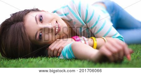 Top view of beautiful young woman holding hands behind head