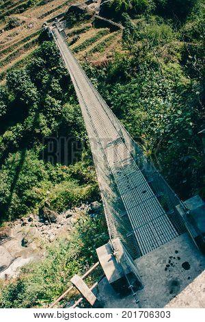 The Chomrong suspended bridge on the Annapurna Base Camp Trek Nepal