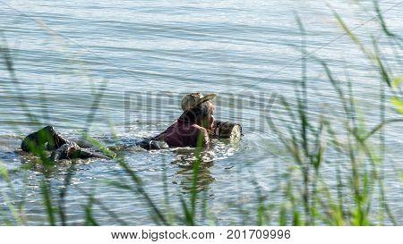 Yo Island Songkhla Thailand - September 4 2016 : This fisherman woman Find shrimp in Songkhla Lake