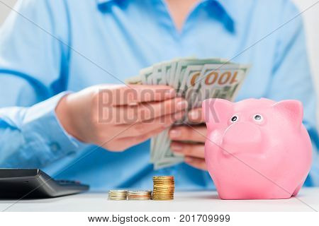 Conceptual Picture Of A Businesswoman's Hand And Money