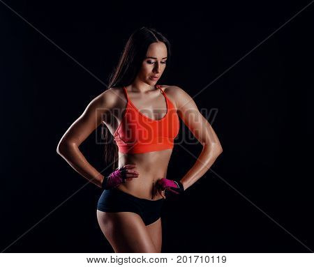 Nice Sexy Fitness Woman Showing Abdominal Muscles Isolated Over Black Background. Trained Female Bod