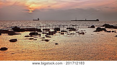 Leghorn (Livorno), Tuscany, Italy: seascape at sunset of the Ligurian sea in front of the port of the city