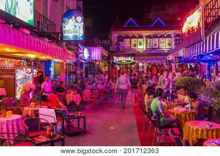 Pattaya, Thailand -March 6, 2017: Walking Street in Pattaya at night. The street is a tourist attraction primarily for night life and entertainment.