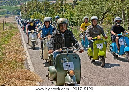 GOROLO DI BORGHI (FC) ITALY - JUNE 3: group of bikers riding vintage italian scooters Vespa and Lambretta in motorcycle rally