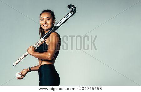Female Hockey Player Looking At Camera