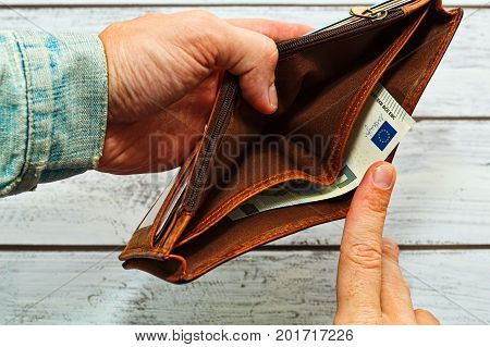 Man Holding Almost Empty Leather Wallet